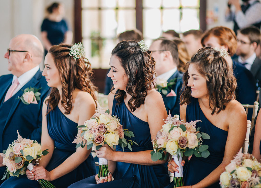 The bridesmaids all sat in a row,