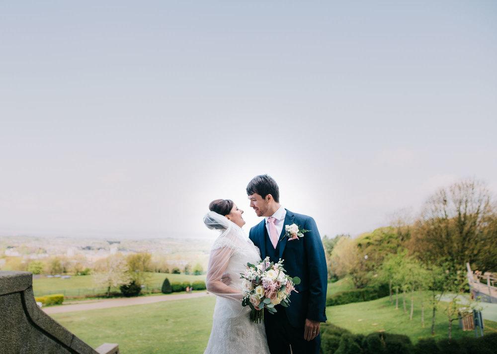 Bride and groom with the views of Lancaster, Lancashire wedding photographer, Ashton Memorial wedding venue.