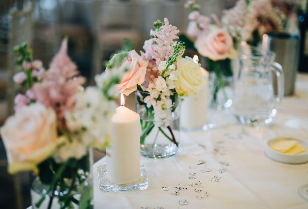 Candles as table decorations, Relaxed wedding at Ashton memorial Lancaster, Documentary styled photographer.