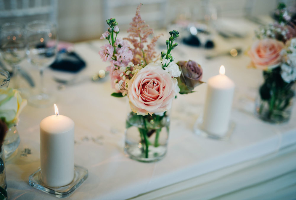 Flowers and candles from the table decorations, Relaxed wedding at Ashton memorial, Lancaster wedding.