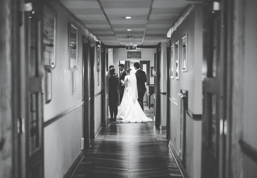 Bride an groom meeting wedding guests, Black and white photography, Creative wedding photography.