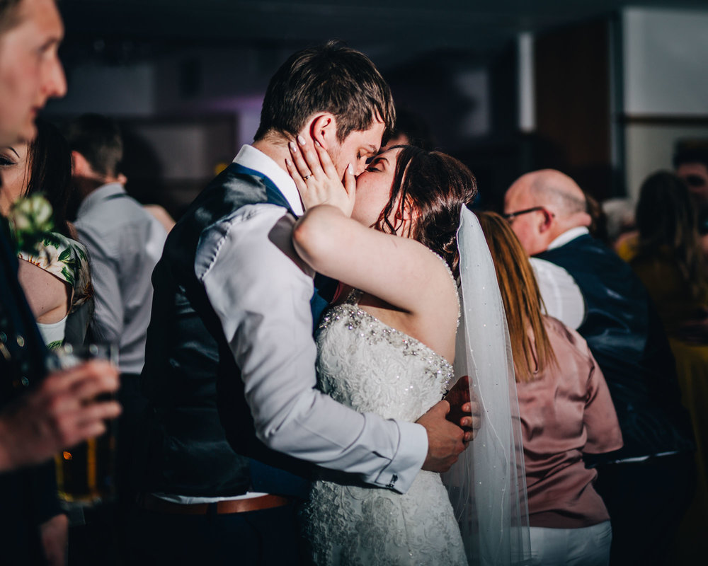 Bride and groom kissing on the dance floor, Documentary style wedding photographer from Lancashire, Lancaster wedding.