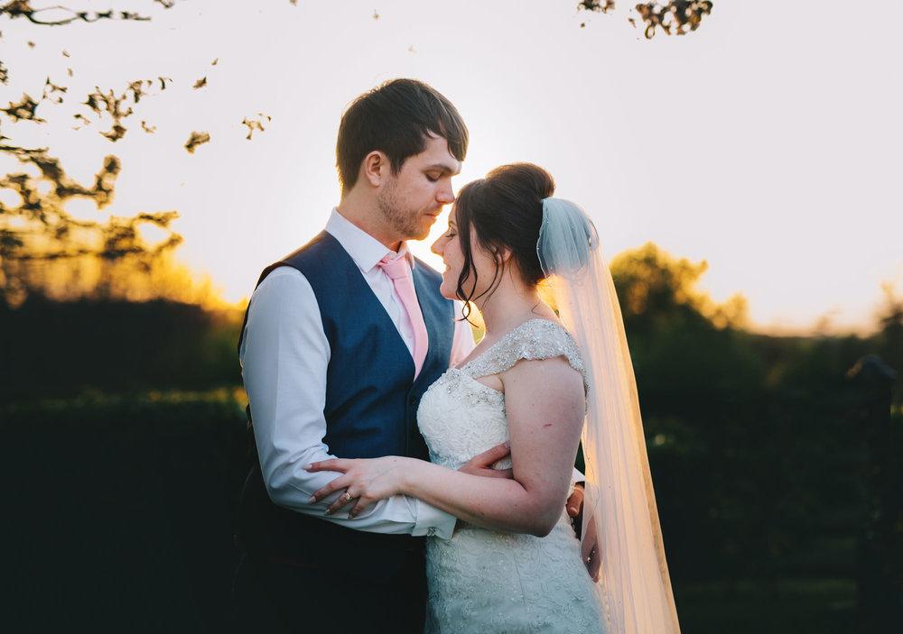 Bride and groom wedding photographs, creative photograph at Ashton Memorial, Relaxed wedding.