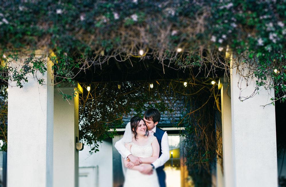 Bride and groom hugging at Ashton memorial, Lancashire photographer, Rustic styled wedding.