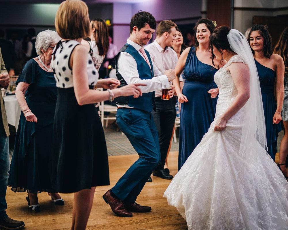 Bride and groom hitting the dance floor, Documentary photographer from Lancashire, Creative wedding photography.