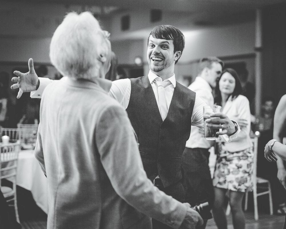 Big hugs from groom to wedding guest, Rustic wedding in Lancaster, Lancashire wedding photographer