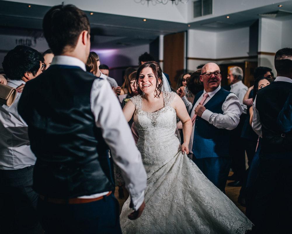 Bride and groom on the Ashton Memorial dance floor, Documentary wedding photographer from Lancashire, Creative wedding photos.