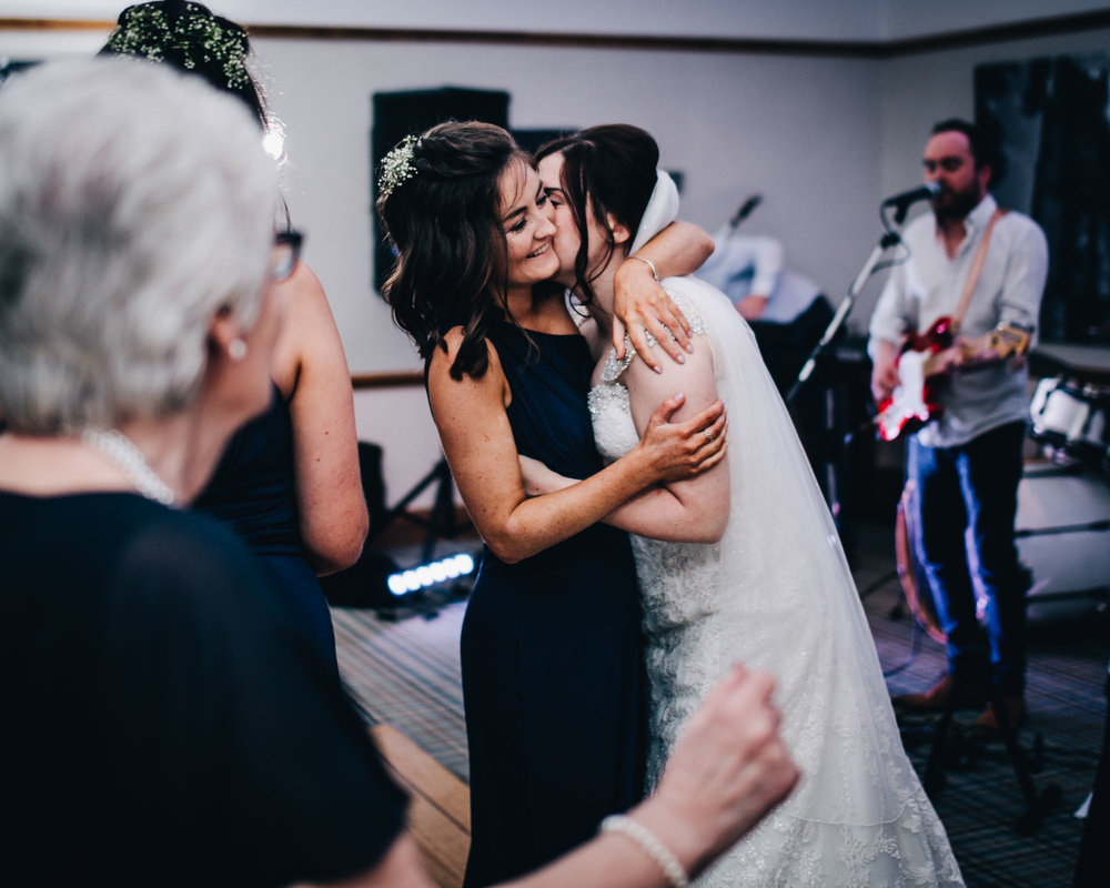 Bride hugging a wedding guest on the dance floor at Ashton Memorial, Creative photography, Rustic themed wedding.