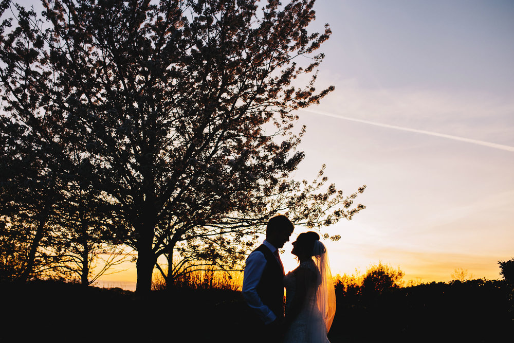 Bride nd groom kissing in the sunset, Creative wedding photography, Calm wedding photos.