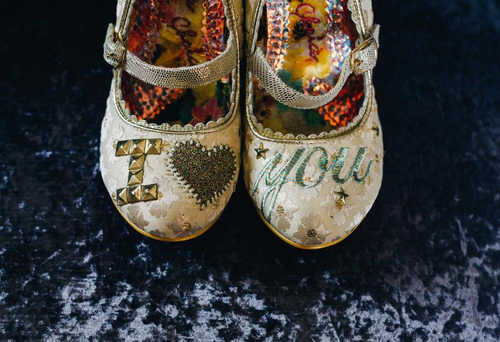 Creative wedding shoes for the bride, same sex wedding photographer, Lake District for a wedding.