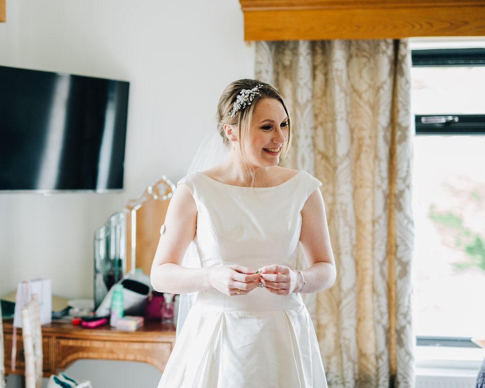 Smiles from one of the brides, same sex wedding, creative wedding photography, pastel themed wedding.
