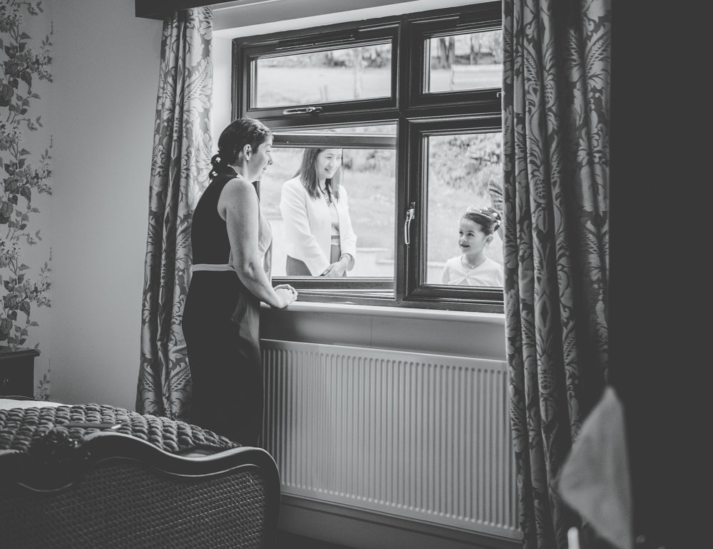One of the brides looking out of the window, Lake district, Same sex wedding, creative photography.