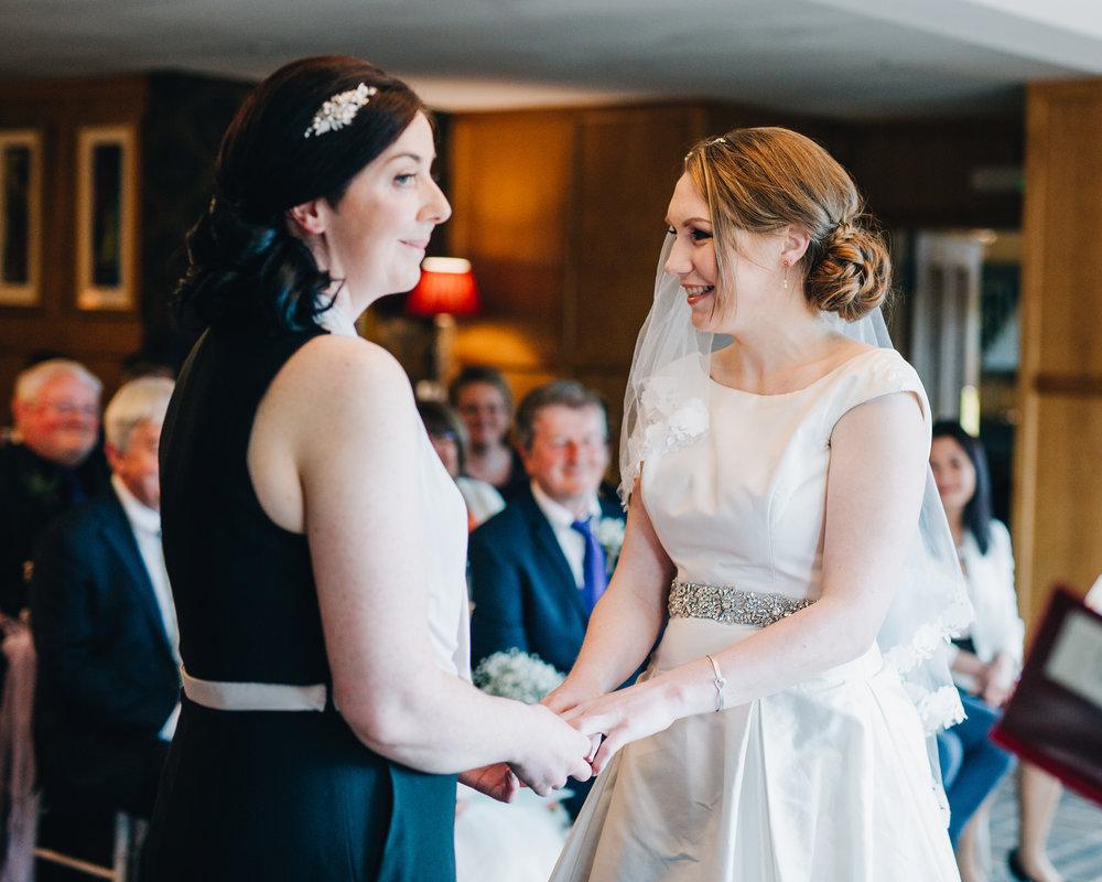 Both brides hand in hand, same sex wedding, creative photography, Lake District wedding.