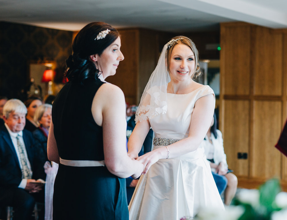 The brides stood at the alter, Lake district wedding, creative photographer from Lancashire, pastel themed wedding.