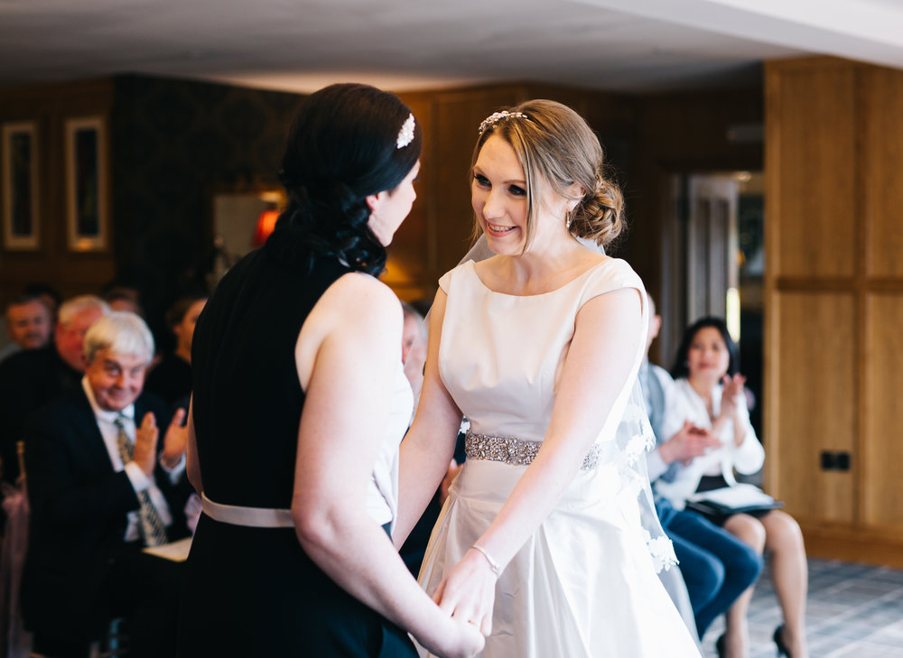 The brides looking at each other, same sex wedding, documentary wedding photographer.