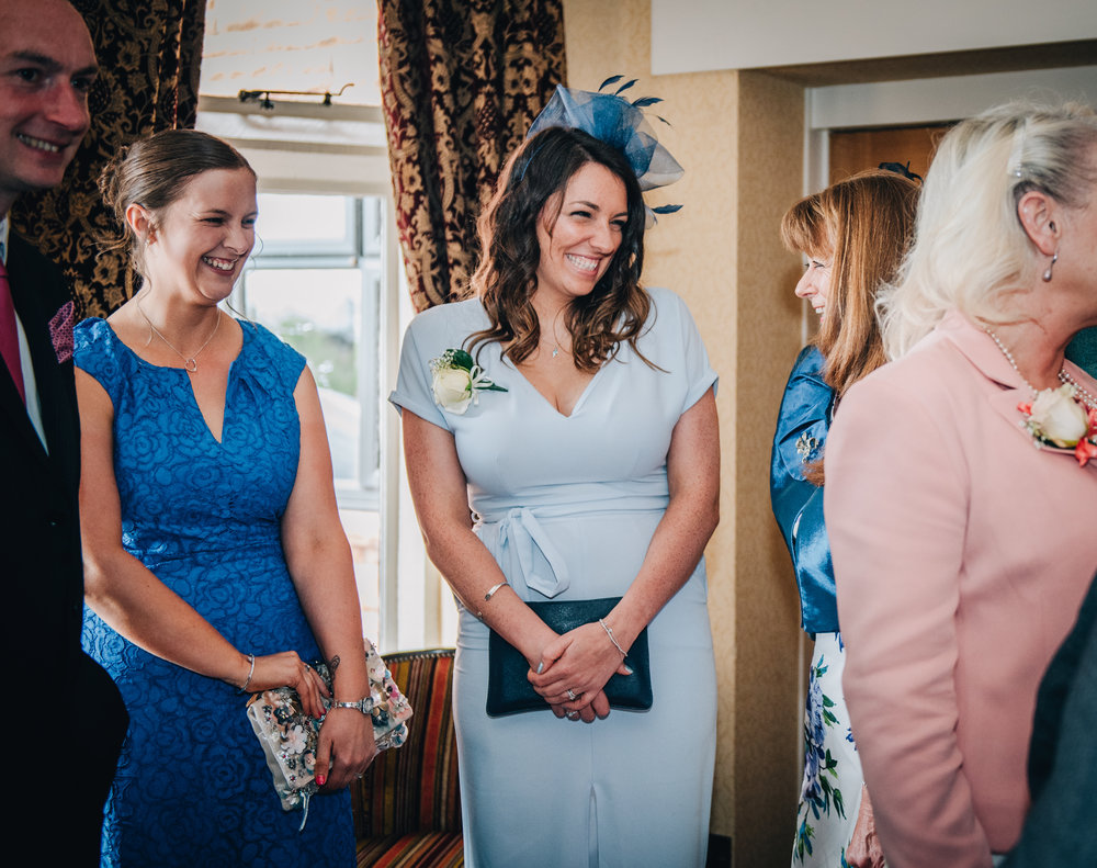 Smiling wedding guests, documentary styled wedding photographer, relaxed wedding.