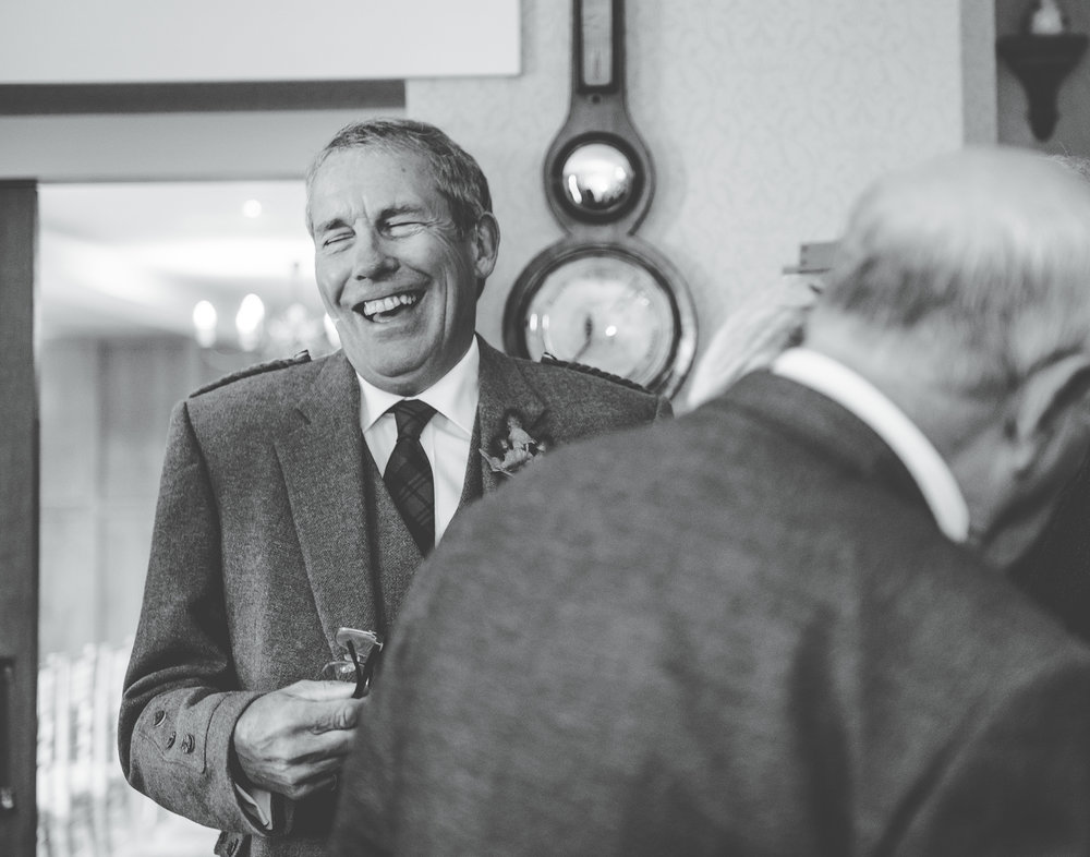 Black and white photo of the wedding guests laughing, creative photography, Lake district wedding, relaxed photography