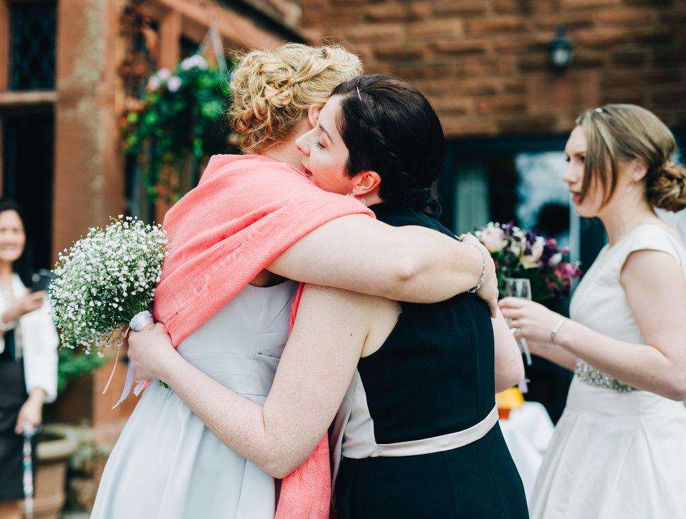 Hugs from the bride, documentary wedding photographer, same sex wedding.