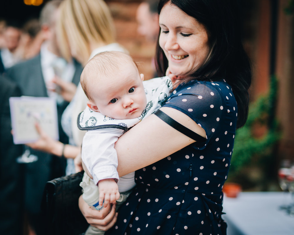 Youngest wedding guest, creative photography, relaxed wedding photography, same sex wedding, pastel themed wedding at the Lake district.