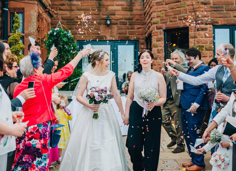 Confetti walk for the brides, same sex wedding, creative wedding photography, relaxed wedding photographer.