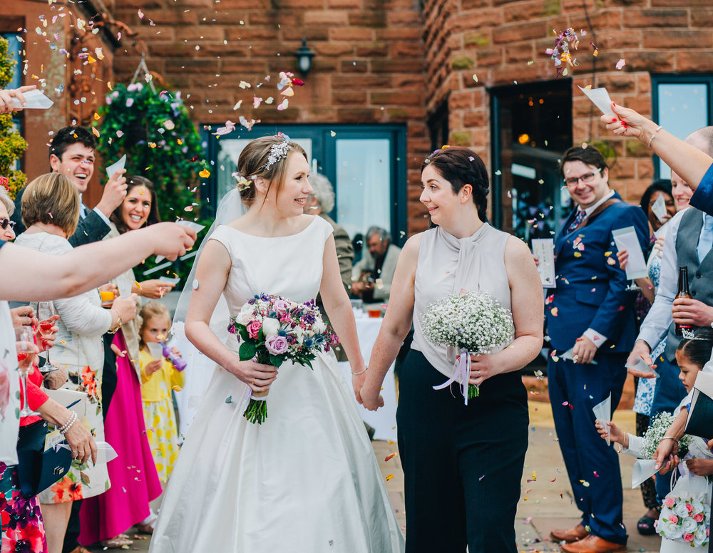 sat of the confetti line, documentary wedding photographer, relaxed wedding, same sex couple wedding.