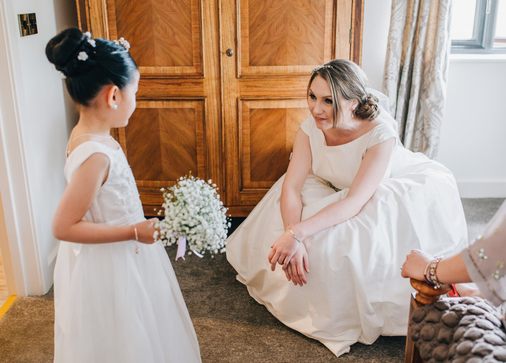 One of the brides and the flower girl, Same sex wedding, creative wedding photography, relaxed wedding.