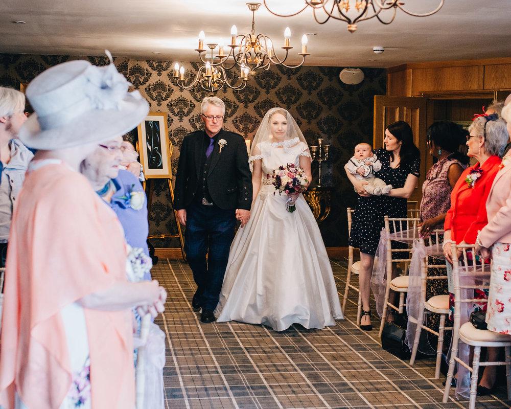 Bride walking down the aisle, same sex wedding, pastel themed wedding, Lancashire photographer.