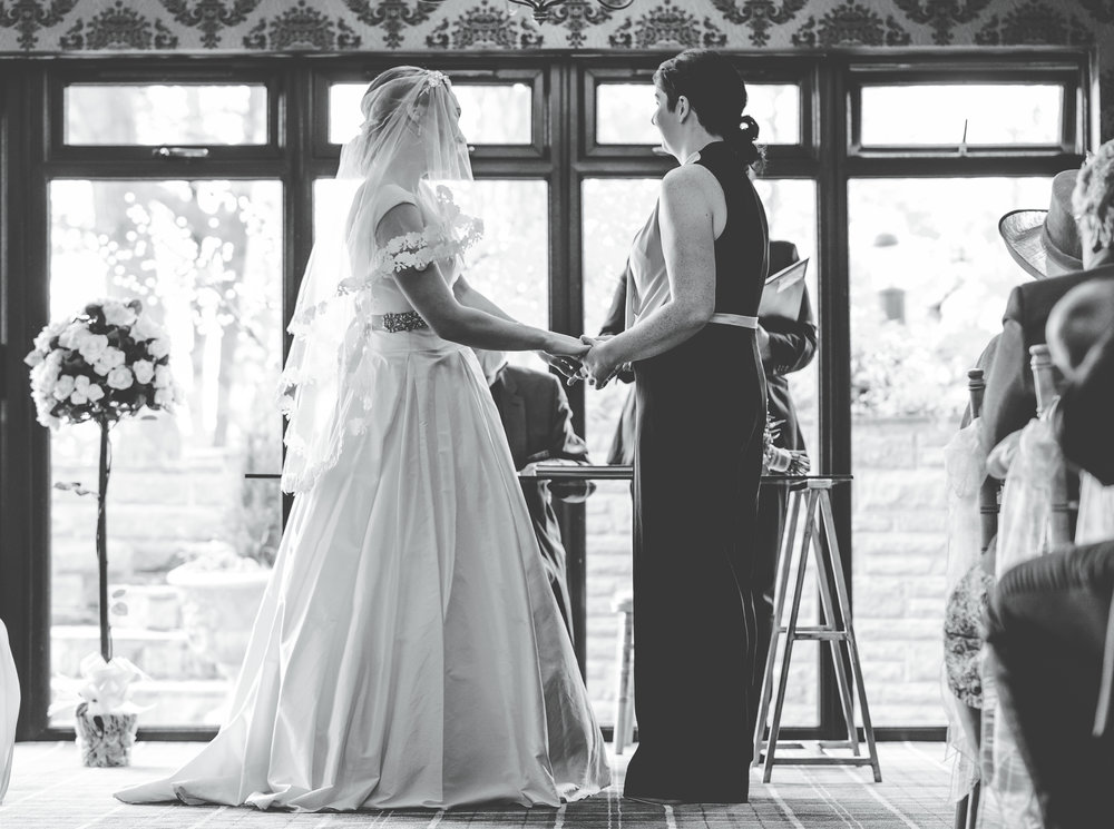 Black and white photograph of brides hand in hand, lake district wedding, same sex wedding, creative photos.