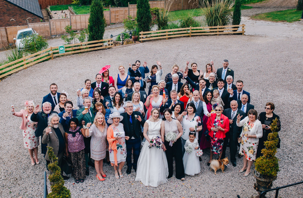 Group shot of all the wedding guests and brides, Lake district wedding, same sex wedding.