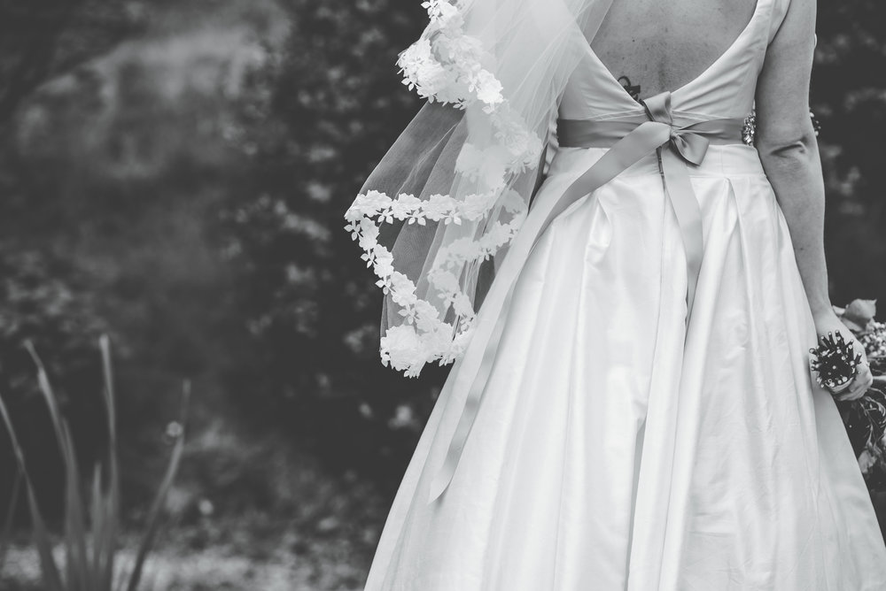 Black and white photograph of the brides dress, creative photos, relaxed wedding.