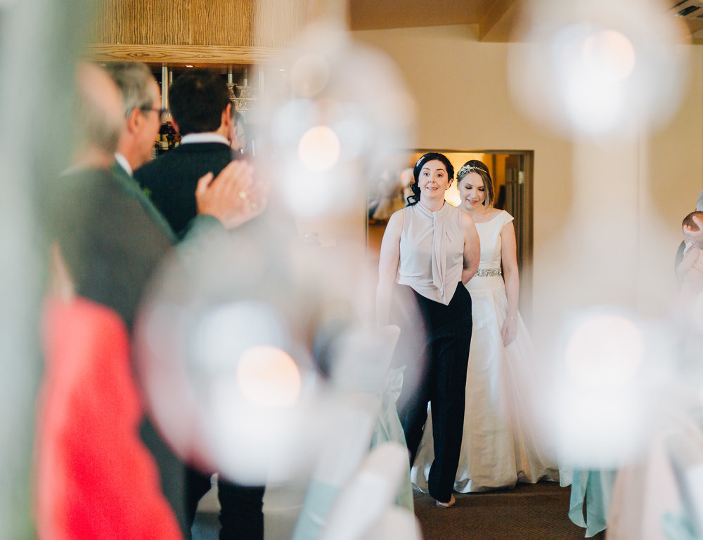 The brides walking into the evening room, documentary photographer form Lancaashire, lake district wedding.
