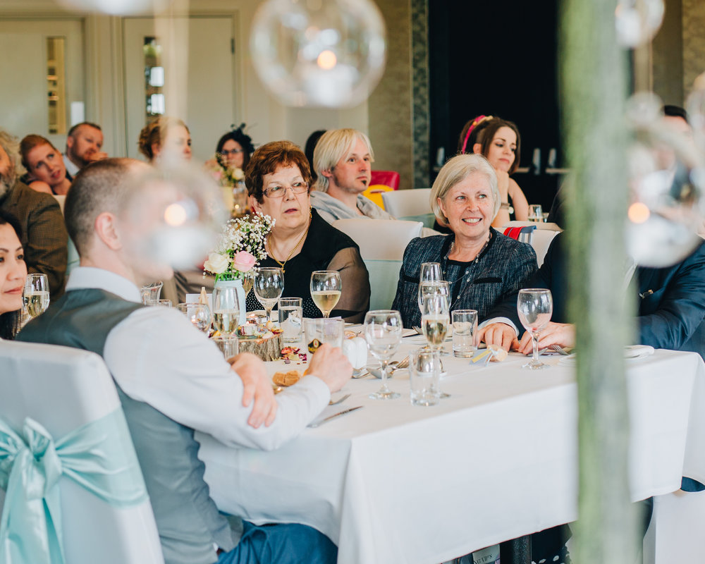 Wedding guests listening to the wedding speeches, documentary styled wedding photography, lake district wedding.