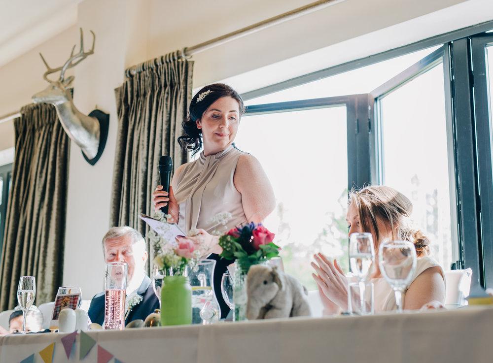 One of the brides wedding speech, same sex wedding couple, creative photography, pastel themed wedding.