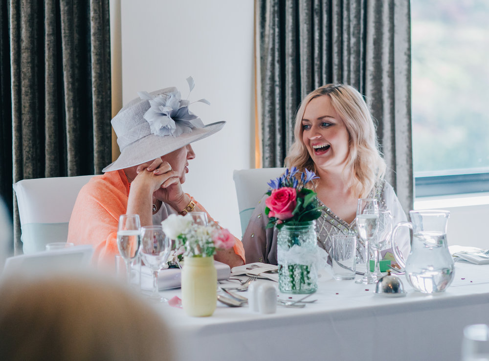 Laughter from the bridesmaid, documentary photography in the Lake district.