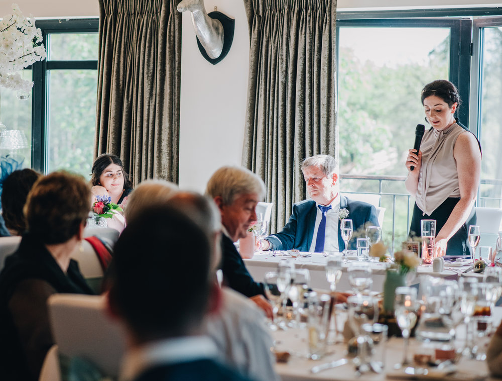Wedding speeches, Pastel themed wedding at the lake district, documentary wedding photography.