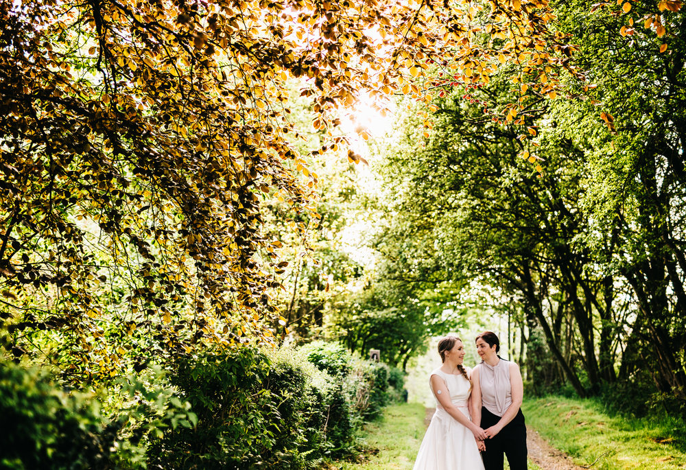 The brides among the trees at the lake district, creative wedding photography, pastel themed wedding.