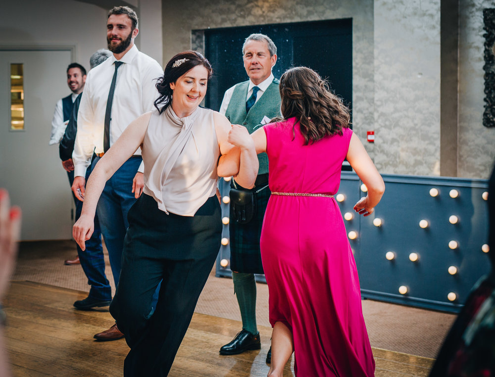 Wedding guest on the dance floor, Documentary wedding photographer from lancashire, relaxed wedding photographer.
