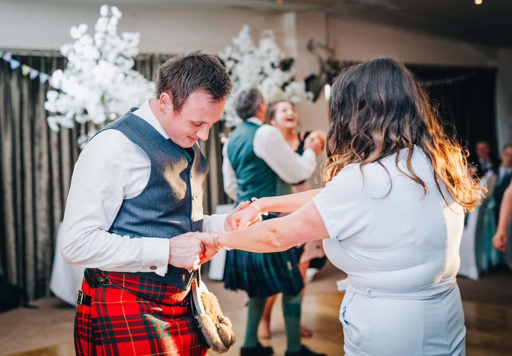 Wedding guests hitting the dance floor, documentary wedding gphotogrpay ay the lake district, pastel themed wedding, relaxed wedding photographer.