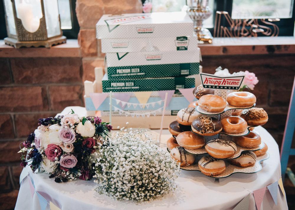 A donut wedding cake, creative wedding photographer, lake district wedding, same sex wedding.