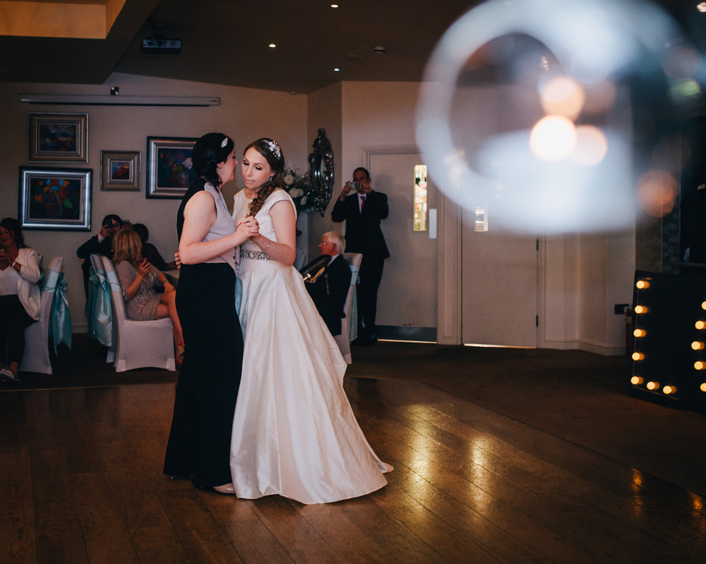 The brides on the dance floor, same sex wedding, creative photography, lake district wedding.