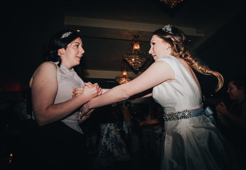 Both brides on the dance floor, same sex wedding, lake district wedding, lancashire photographer.