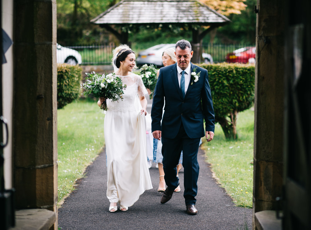 The bride and her father about to walk down the aisle, Lancashire wedding photographer in the Ribble valley.