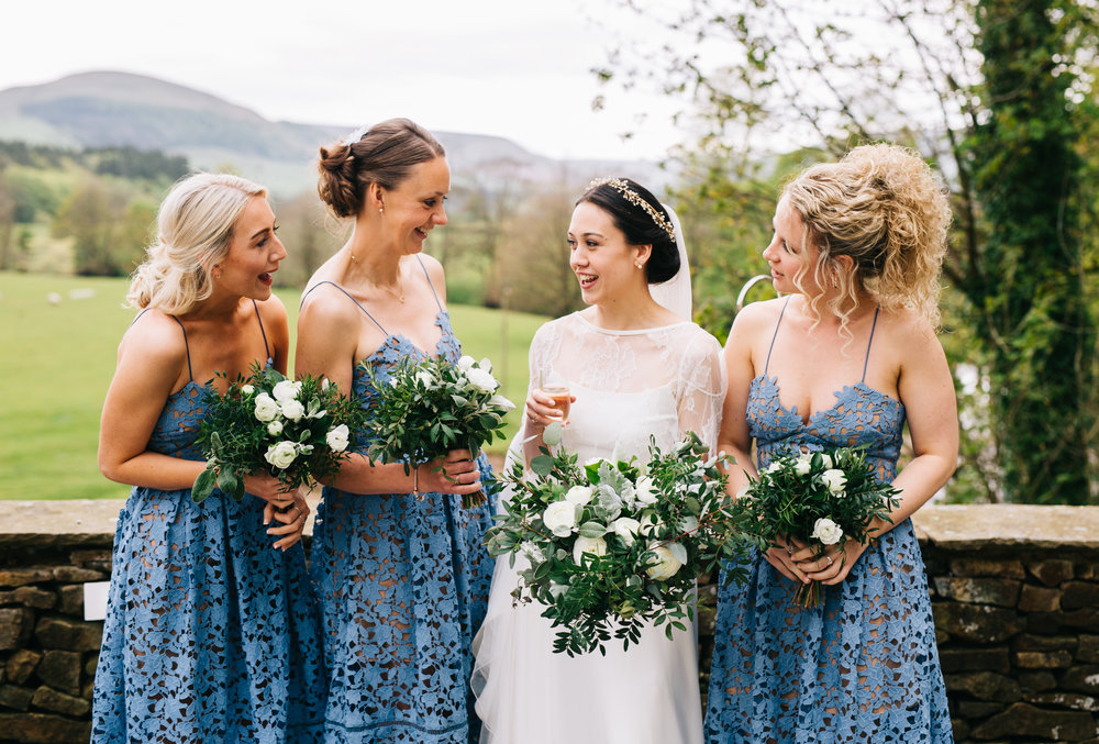 The bride, bridesmaids and the wedding bouquets, The inn at Whitewell, Calm relaxed wedding.