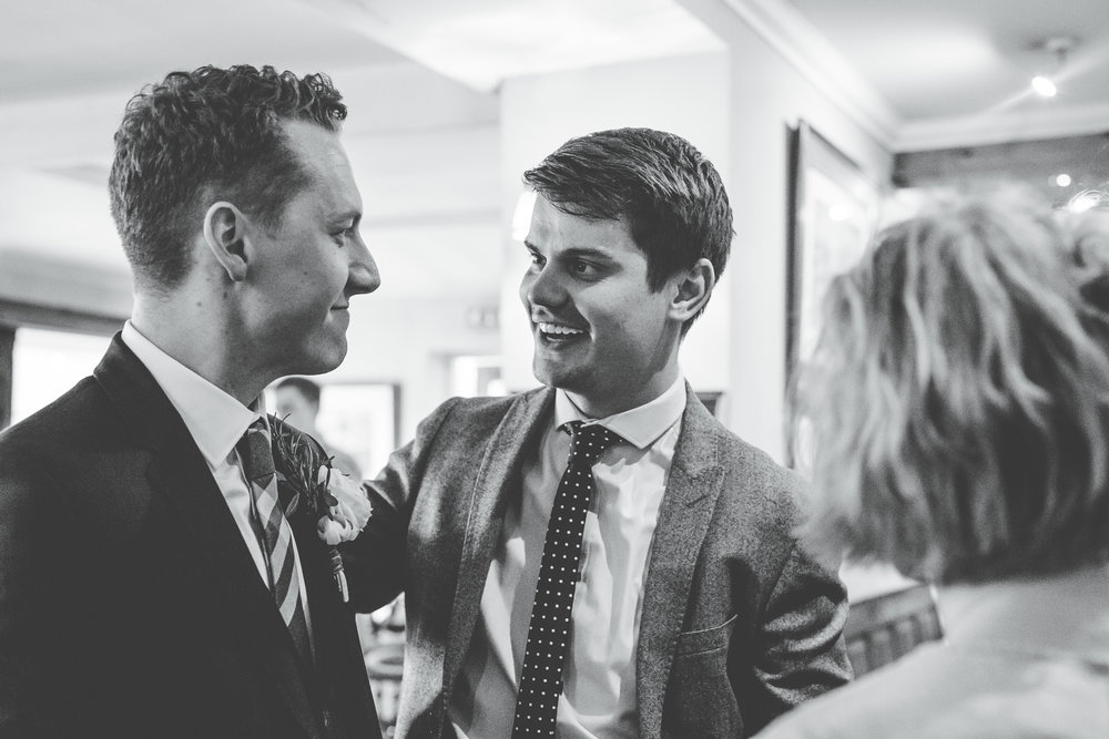 Smiles from wedding guests, Black and white photography, Documentary themed wedding photography in lancashire.