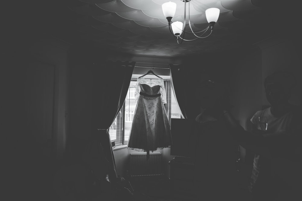 Black and white photograph of the brides dress, Wellbeing Farm as a wedding venue.