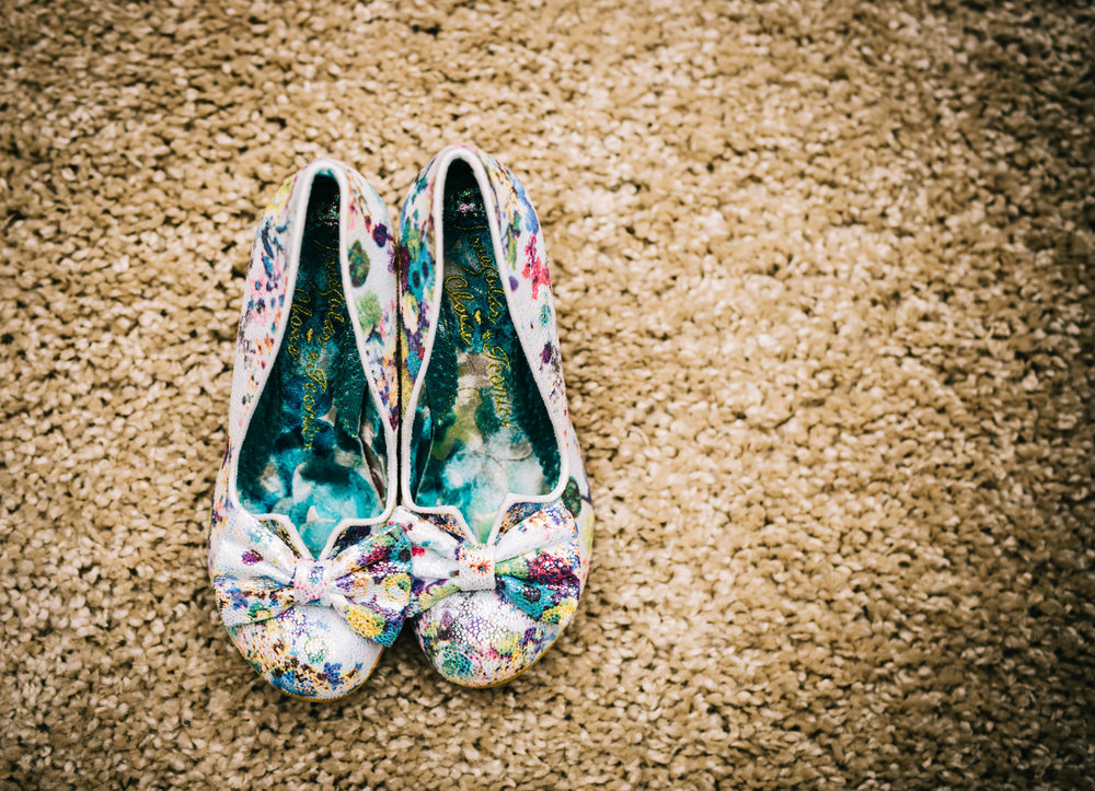The brides colourful shoes for her wedding.