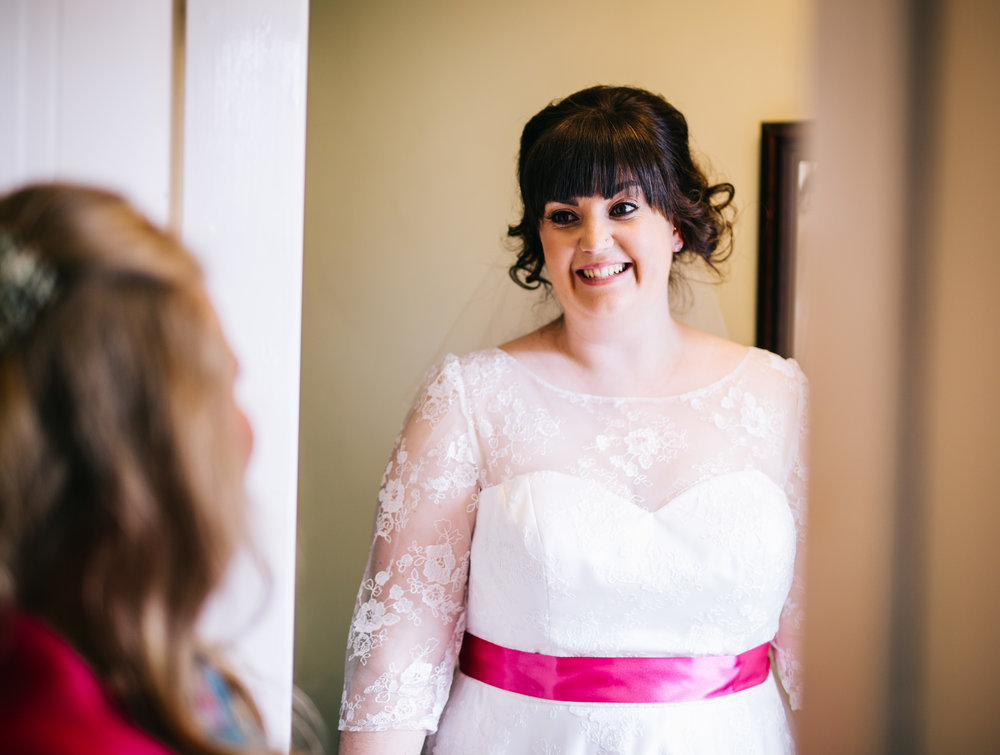 Smiles from the bride before her farm wedding, Wellbeing farm.