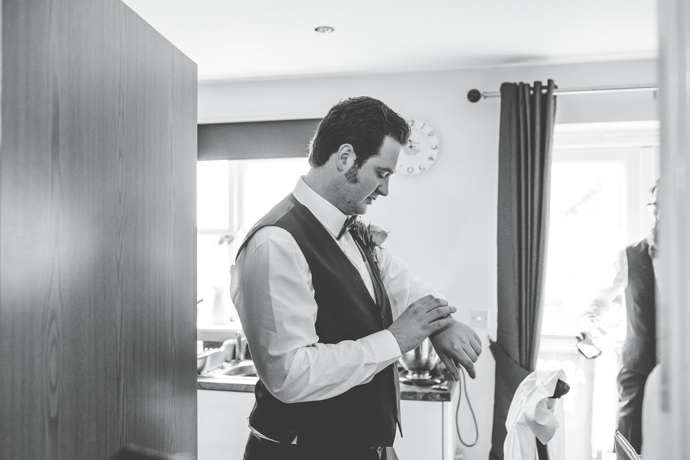 Black and white photograph of the groom getting ready, creative wedding photographer in Lancashire.