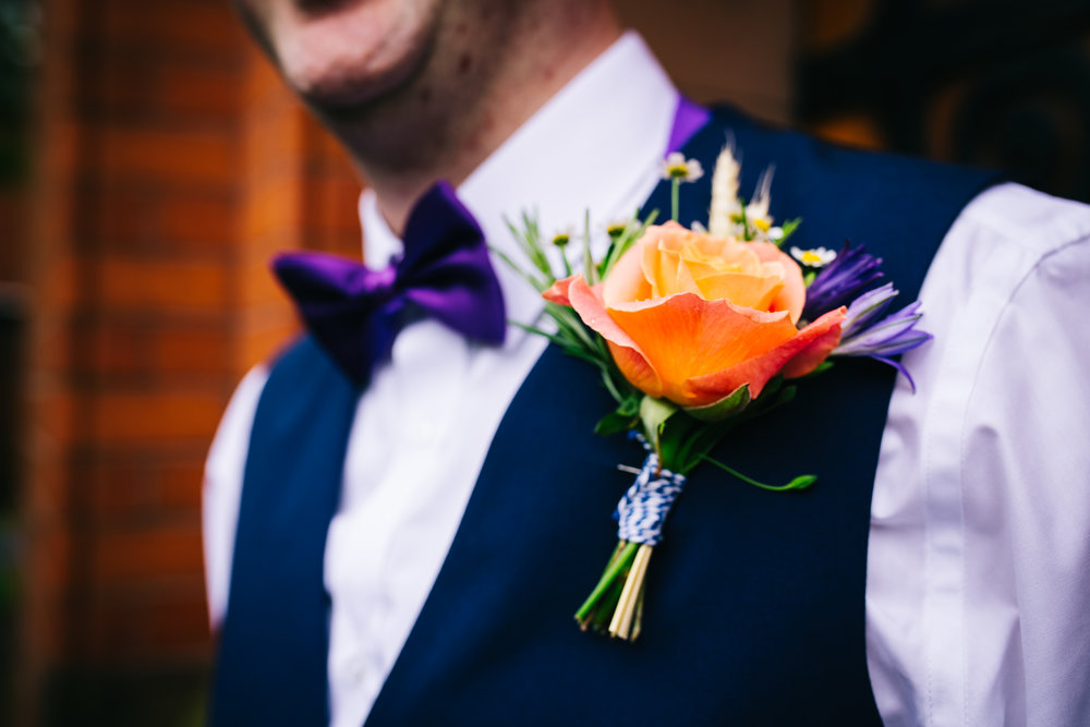Colourful quirky flower for the groom.