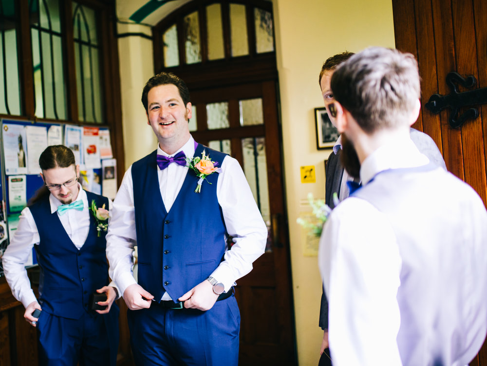 Laughter from the groomsmen, Documentary wedding photography.